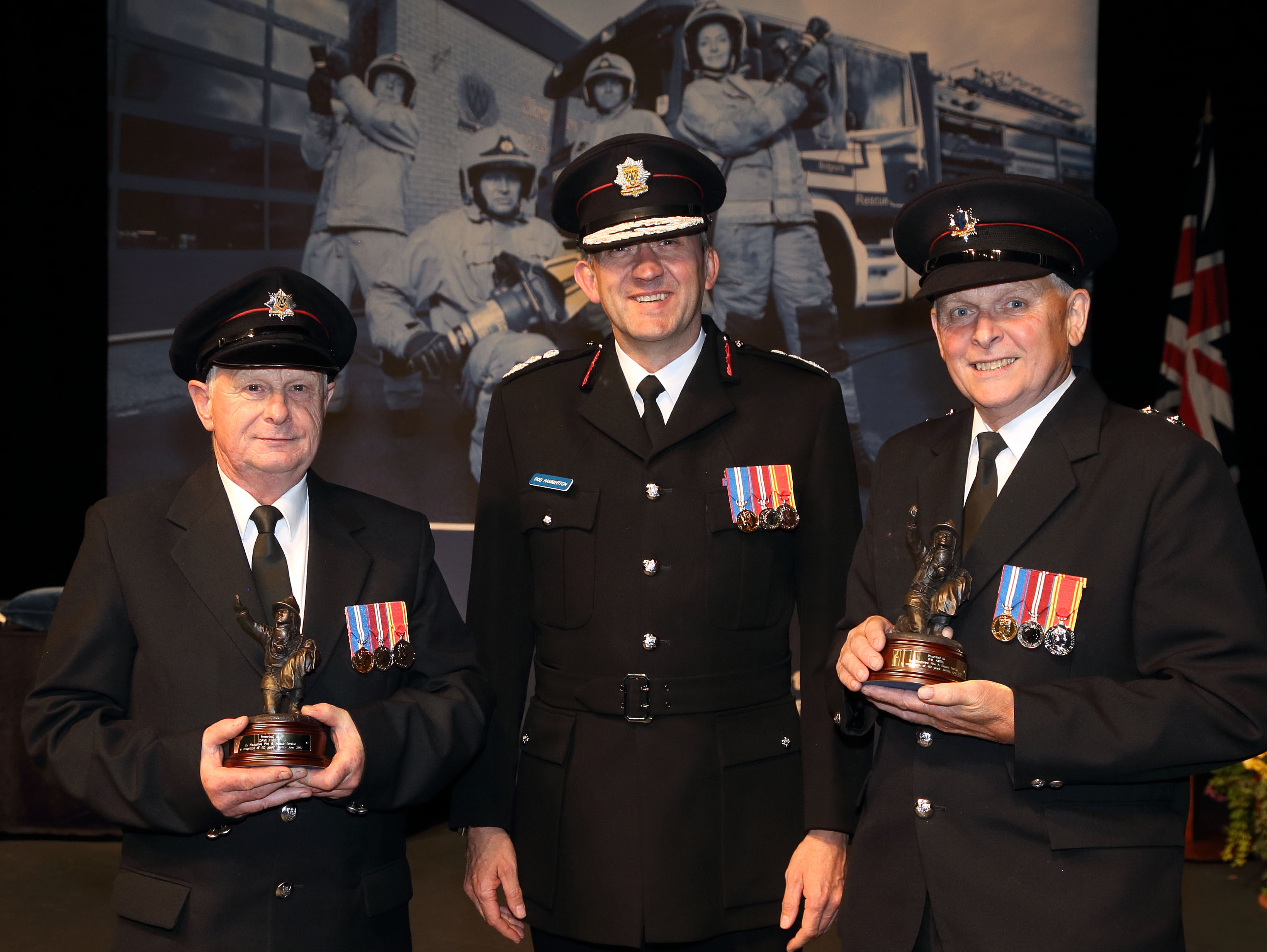 Wem firefighters Phil Smith and Dave Furber celebrate more than 40 years service each, pictured with Chief Fire Officer Rod Hammerton.