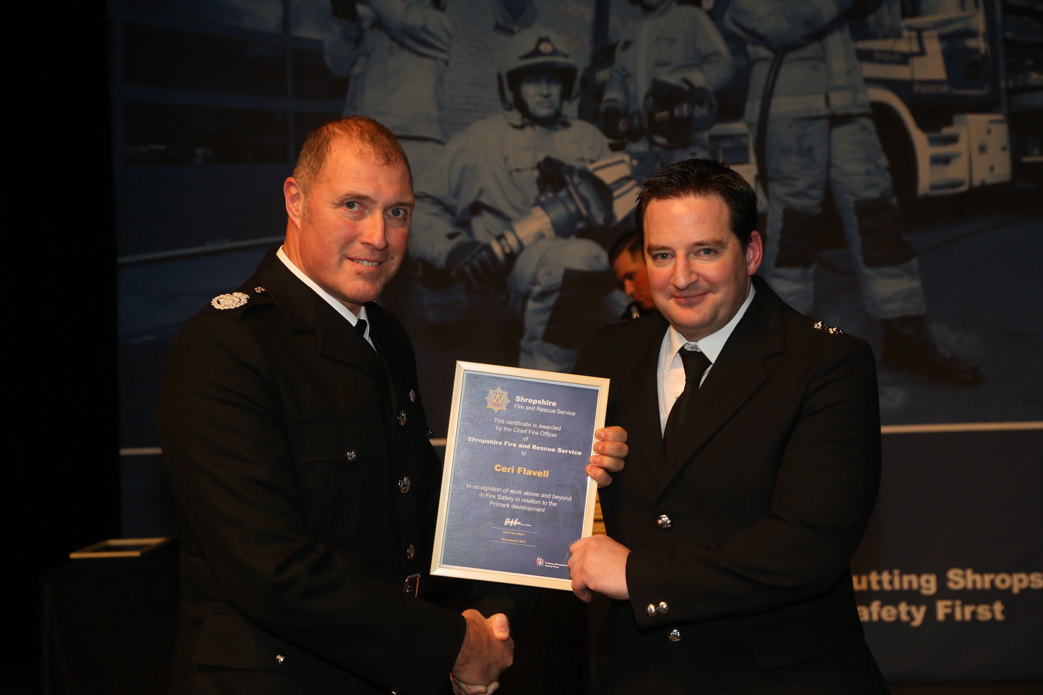 "Ceri Flavell receives his award for work ""above and beyond"" in fire safety"