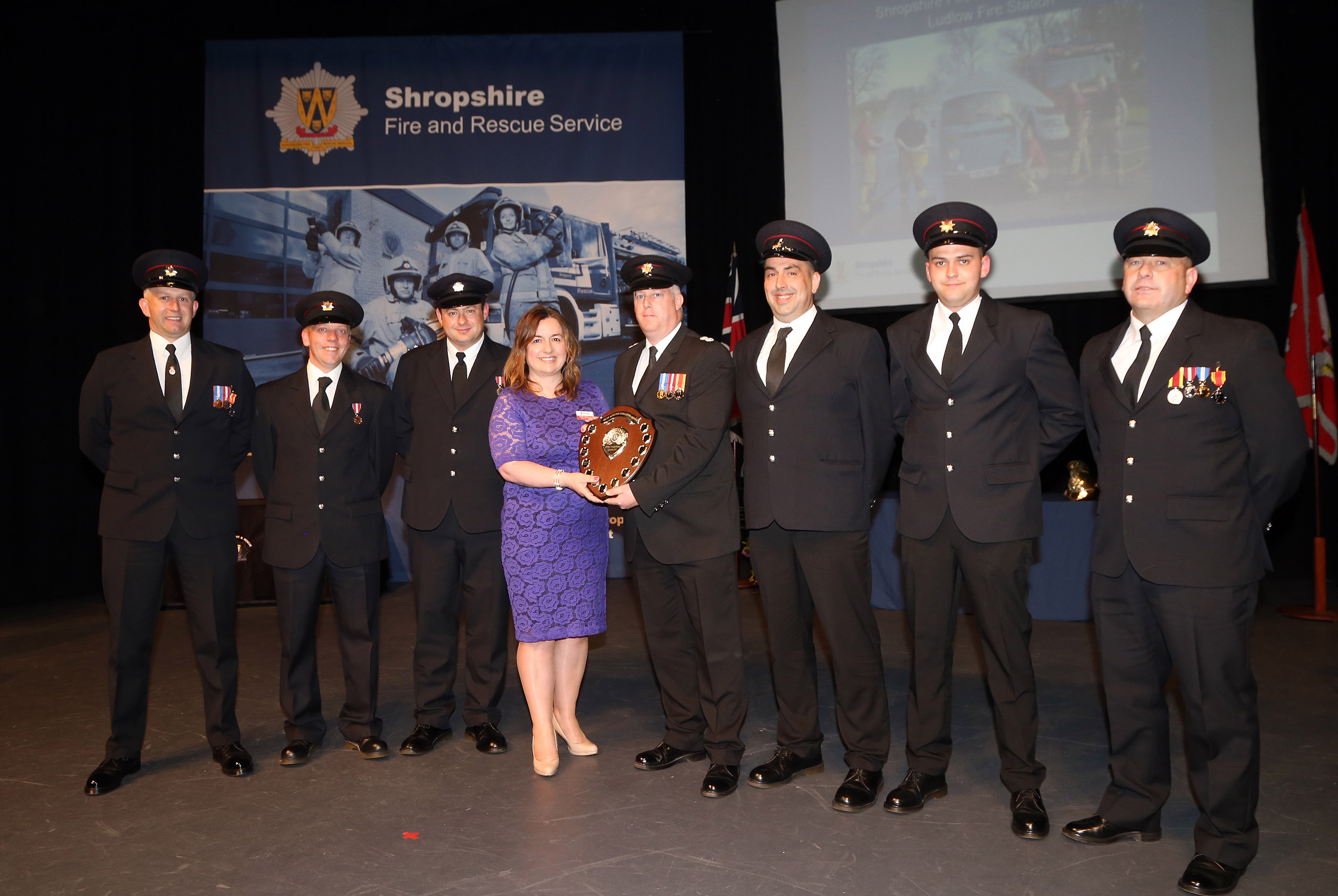 Ludlow Fire Station was awarded the Dave Bishton Challenge Shield for raising more than £4,000 for the Fire Fighters Charity over the past year. Pictured are, left to right, Steve Perks, Mark Nicholas, Ashley Brown, Charity fundraising officer Debbie Rushbrooke, Watch Manager Glyn Davies, Shaun Harrison, Olie Powis and Graham Oliver.