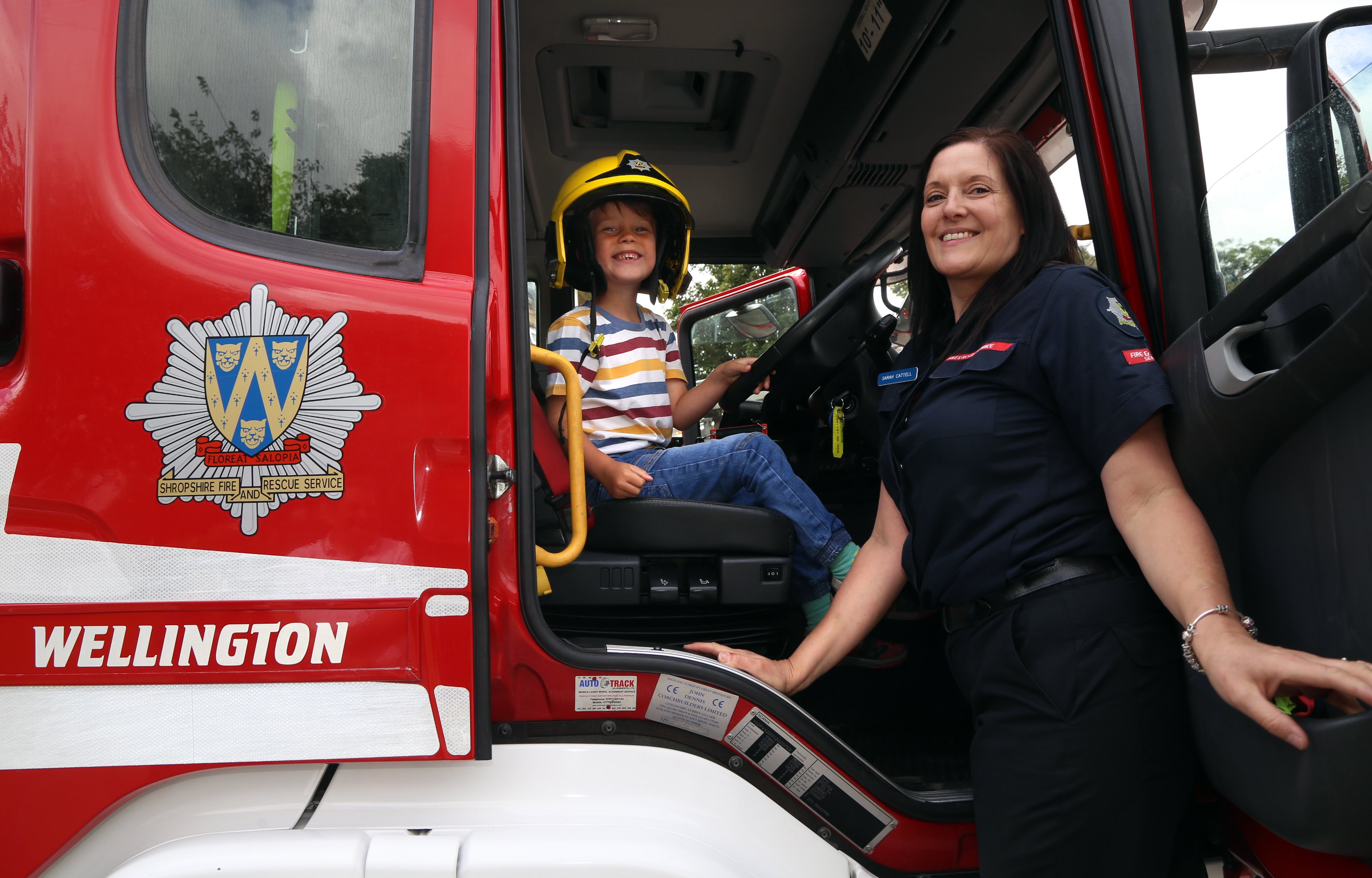 It's fun in a fire engine. Ethan Armstrong, from Telford, with firefighter Sarah Cattell.