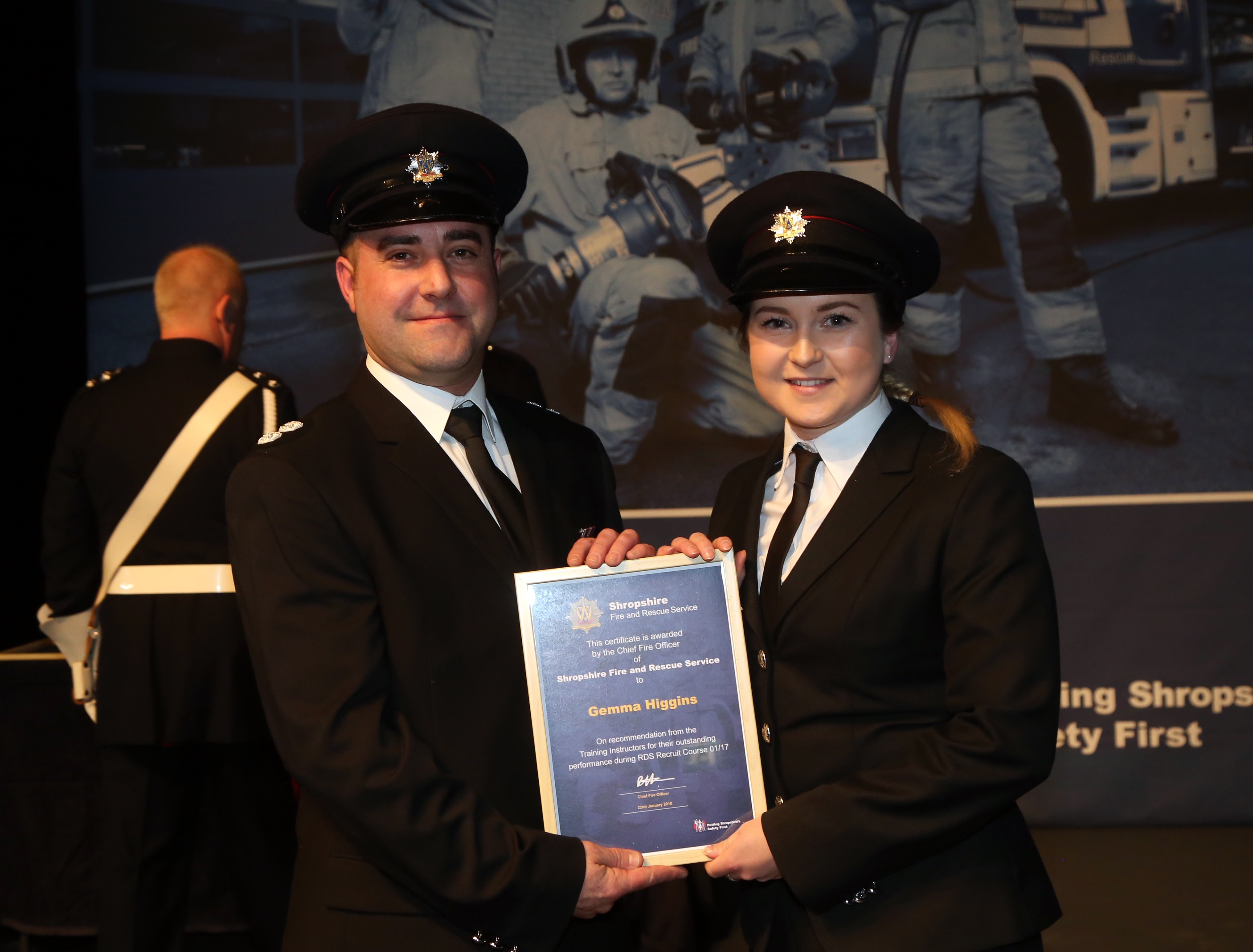 Firefighter Gemma Higgins, from Wem was one of three new recruits to receive an award from instructor Matt Angell for their outstanding performance during training