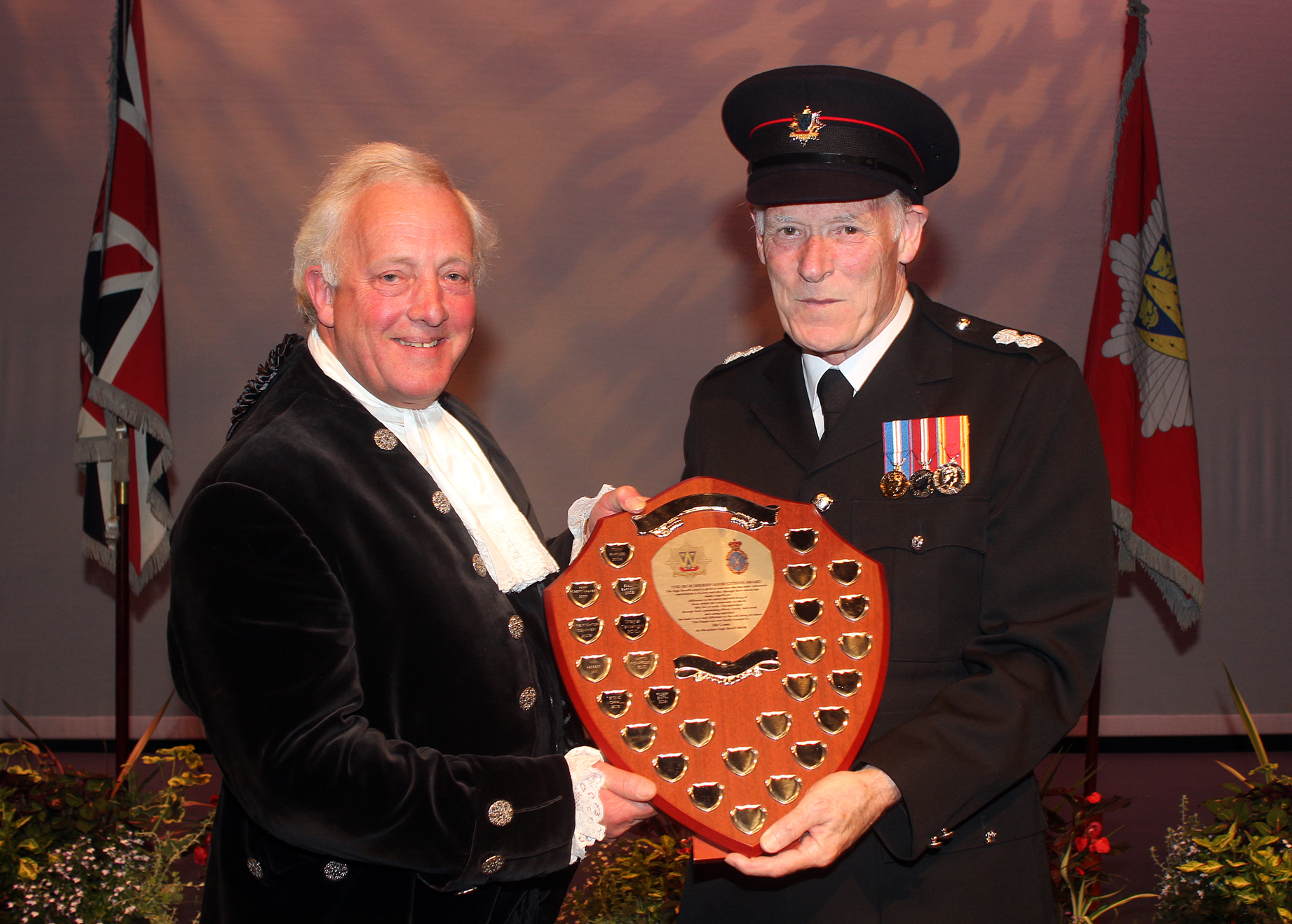 Shropshire High Sheriff Roger Bland presents Roger Smith with his award