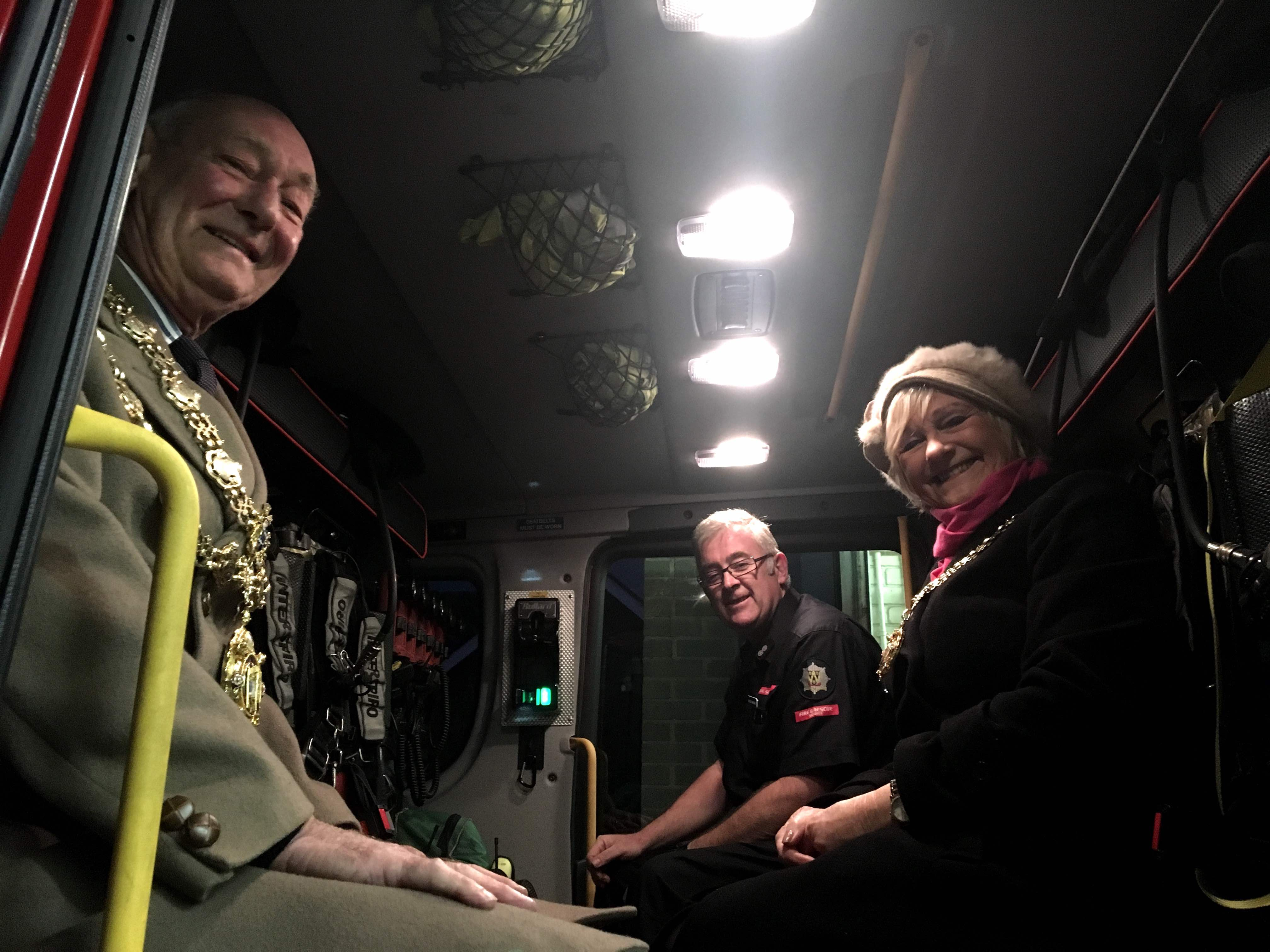 Much Wenlock Mayor, Councillor Graham Edgcumbe Venning and wife Christine take a seat aboard the new fire appliance with Watch Manager Alastair Humphries.