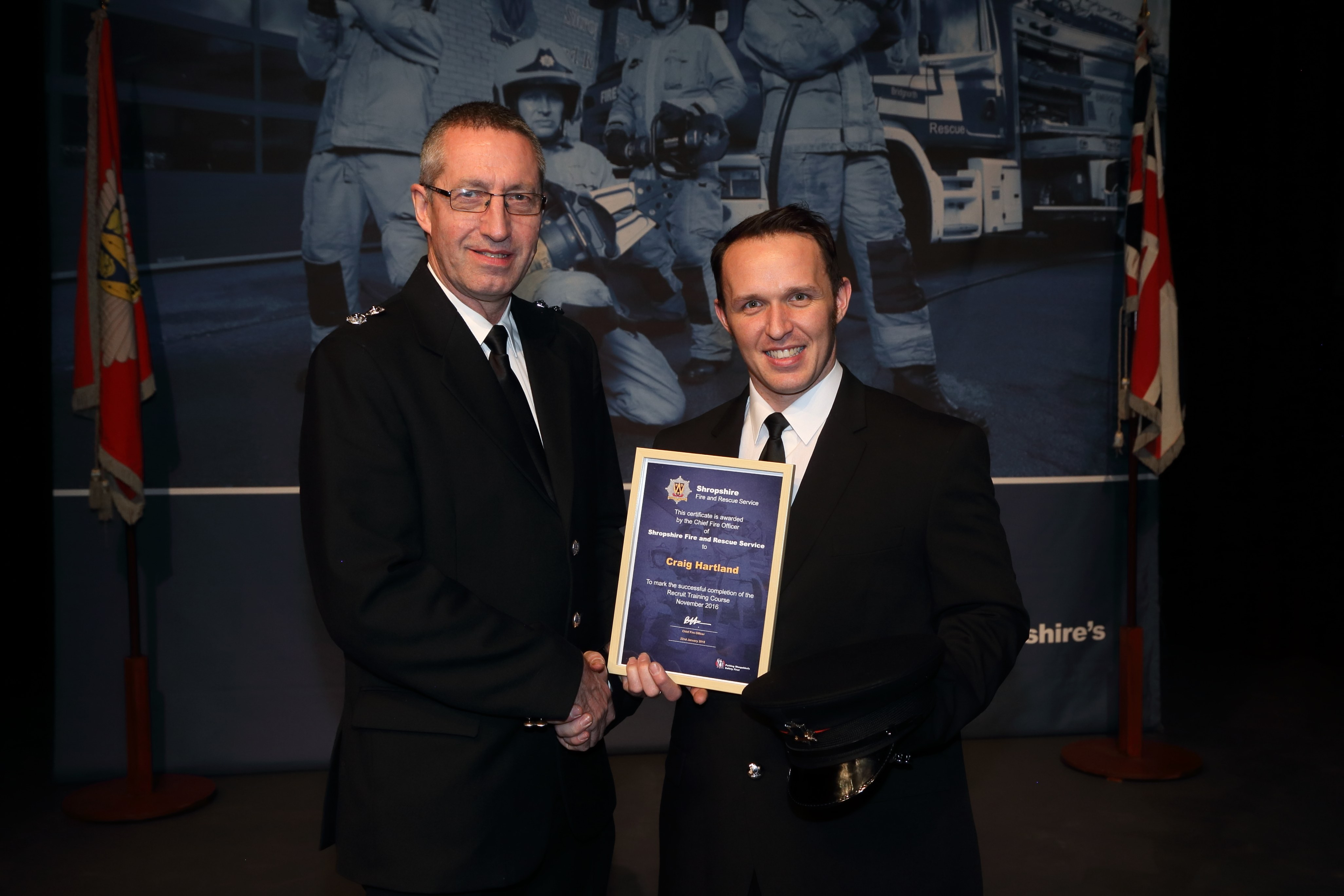 Aldi supermarket stock assistant Craig Hartland receives his certificate from Newport Watch Manager Charlie Cartwright.(left)