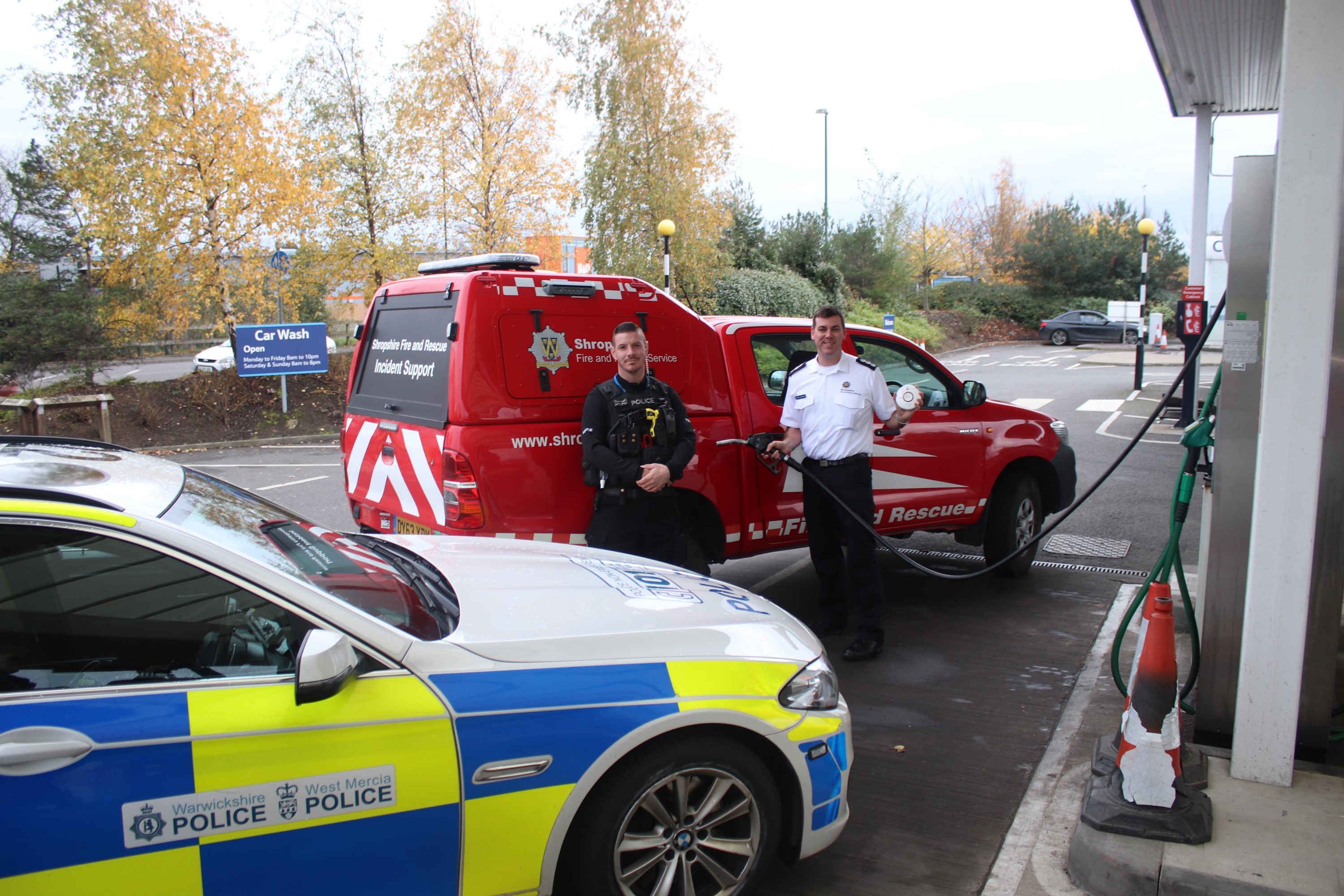 Station Manager James Bainbridge and PC Richard Bramwell launch a joint fire and police safety awareness campaign at the petrol pumps as part of Road Safety Week 2017