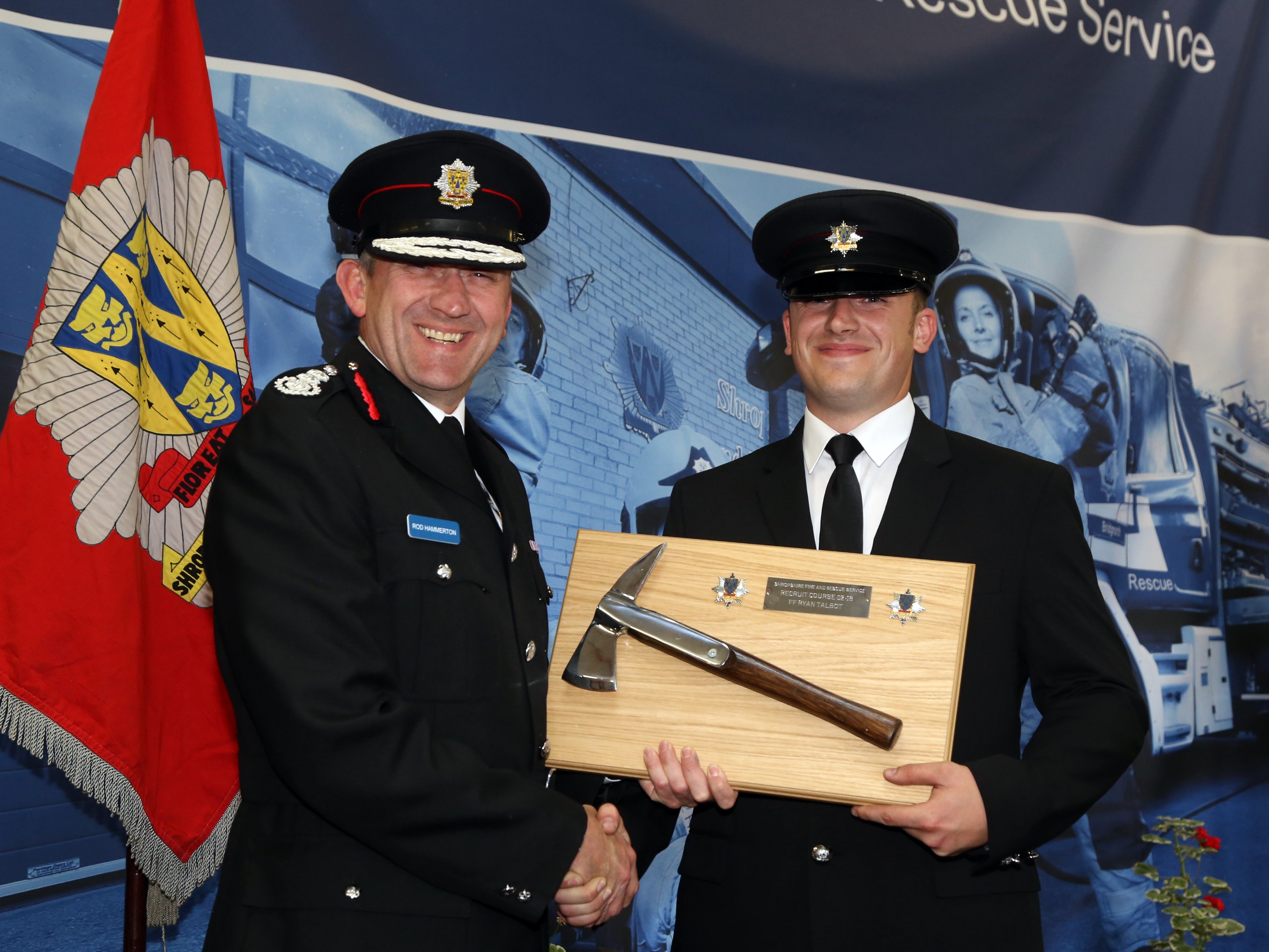 Telford firefighter Ryan Talbot receives the Silver Axe award for top student from Chief Fire Officer Rod Hammerton