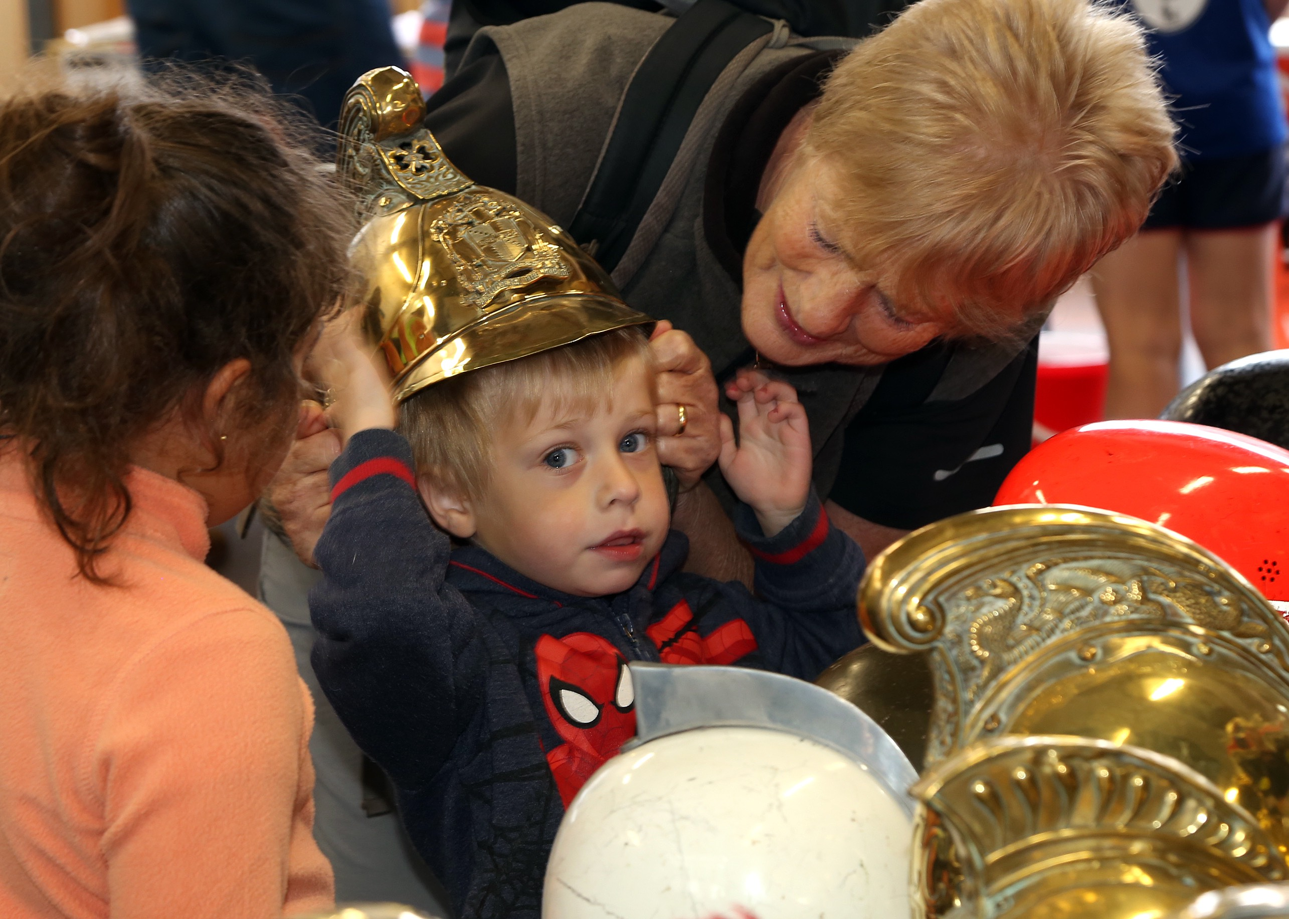 Ben Jones (aged 3) tries on a firefighter's helmet for size pictured with his grandmother Sue Challinor, from Shrewsbury.