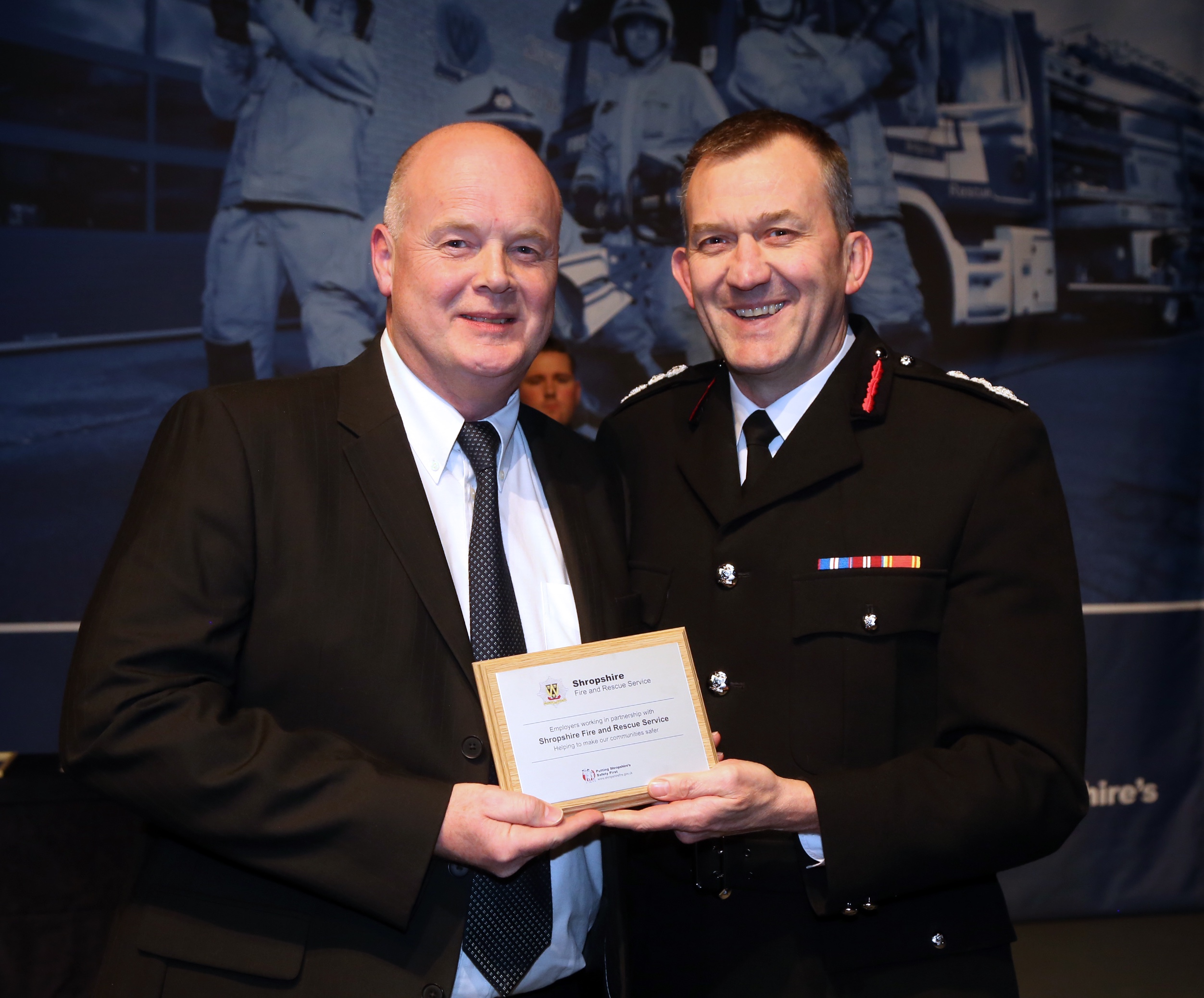 Europa Fastenings MD Stephen Cowan with the employers' award from Chief Fire Officer Rod Hammerton