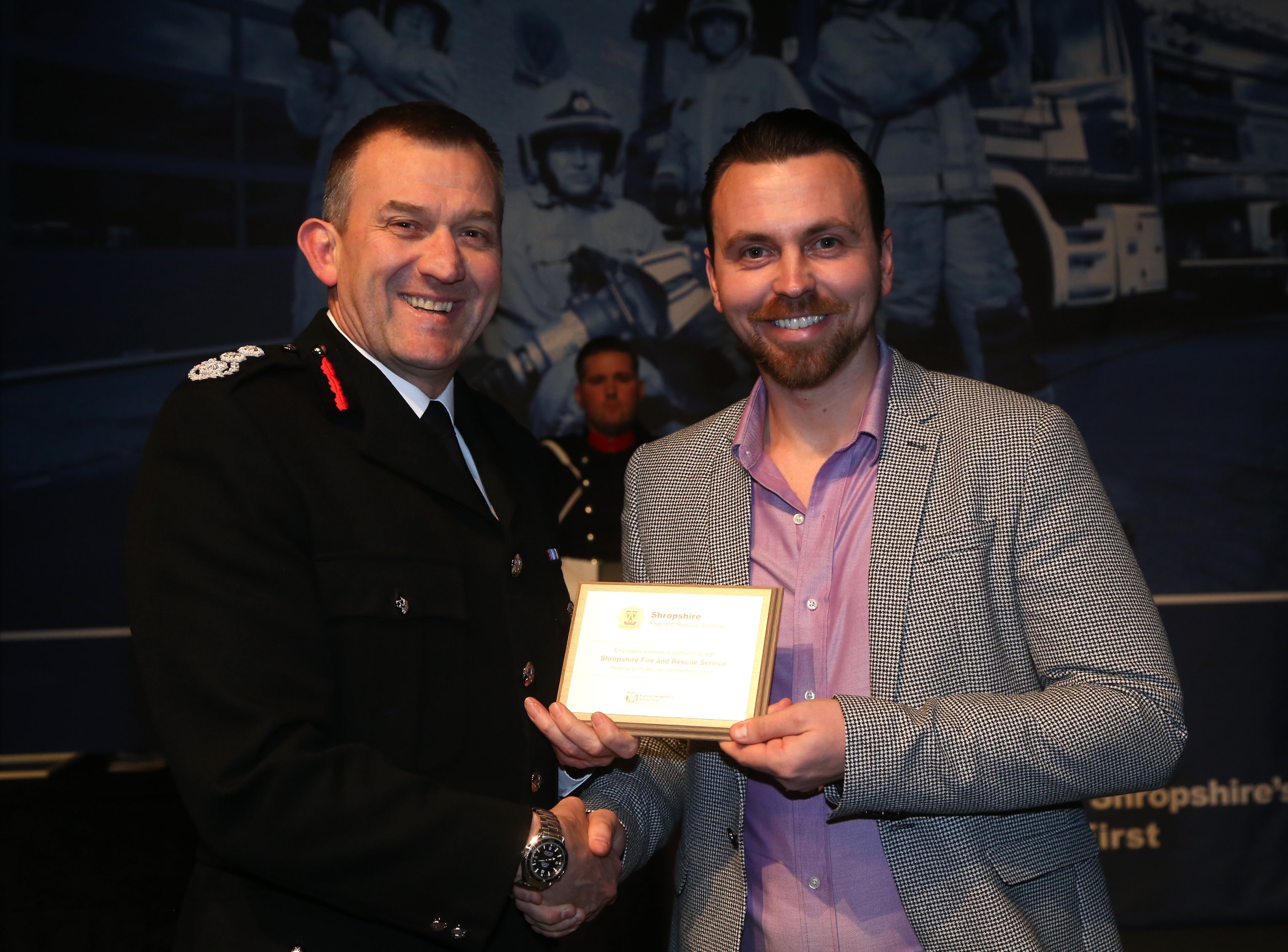 Tom Pain, from Cleobury Mortimer golf club, with the Chief Fire Officer