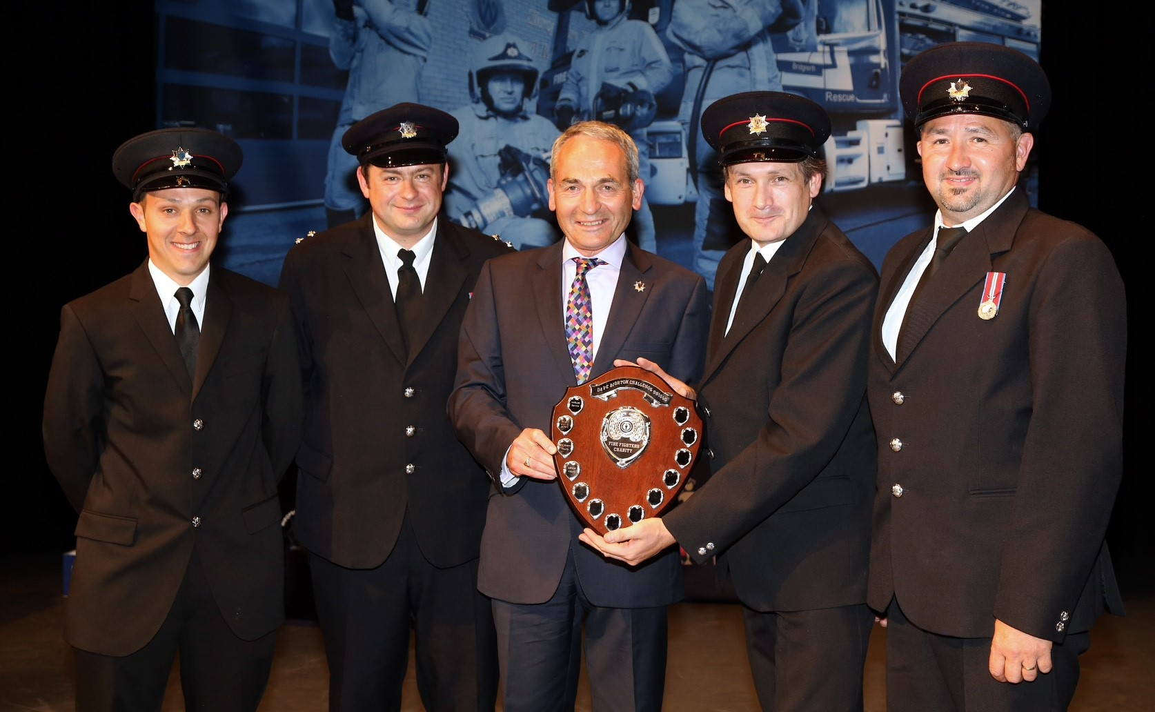 Councillor Keith Roberts (centre) presents the Dave Bishton Challenge Shield to Bridgnorth Fire Station's Joe Smallman, Ashley Brown, Steve Power and Ian George.