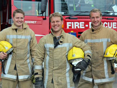 Brothers pictured in fire kit in front of fire appliance