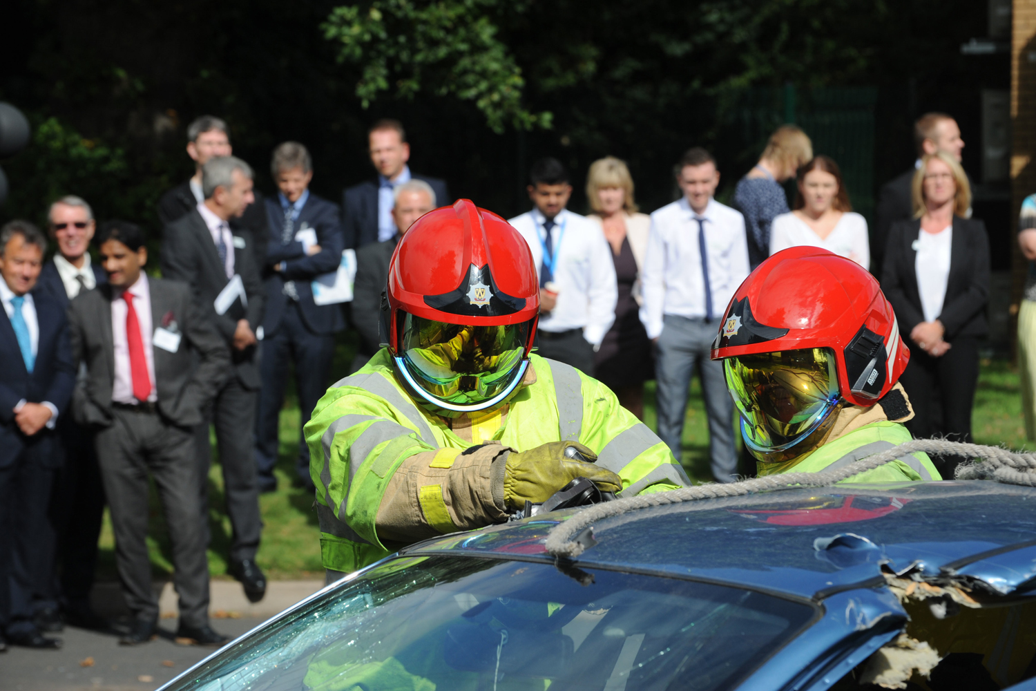 Lord Digby Jones with left to right Shropshire Chief Fire Officer John Redmond and TTC Group Road Safety Director Alan Prosser with firefighters after a car extrication demo as part of the business driver road safety campaign.