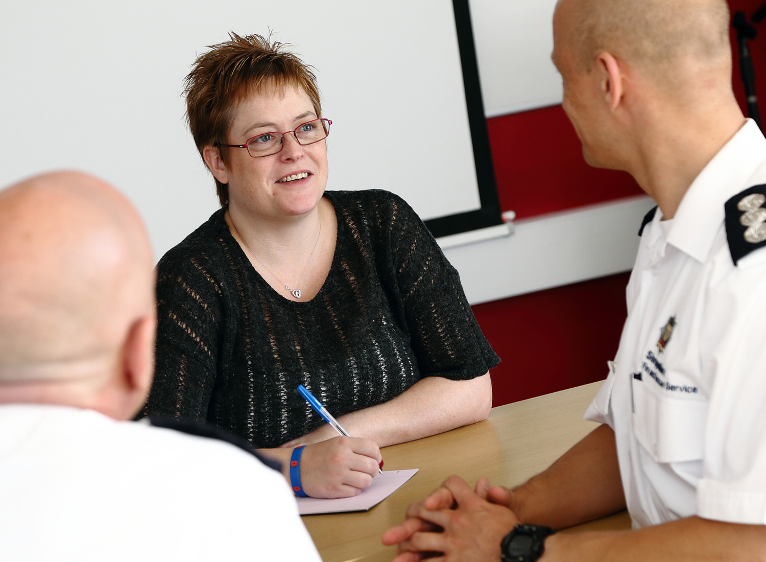 Admin Support Officer Becci Dickens takes the minutes at senior officers' meetings