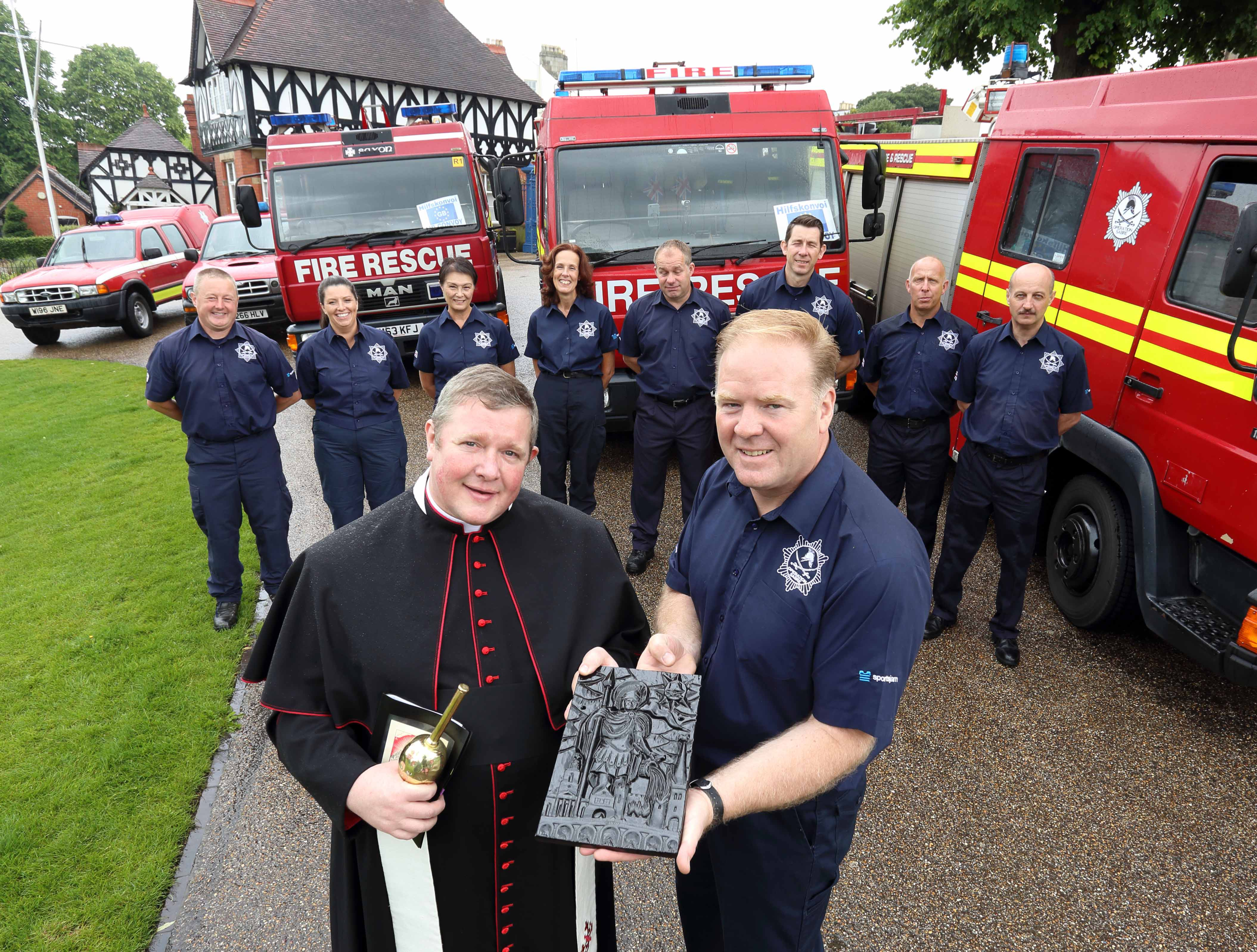 The Very Reverend Canon Jonathan Mitchell with Dr Steve Worrall at the blessing of the fire appliances before Shrewsbury charity Operation Sabre sets off for Romania.