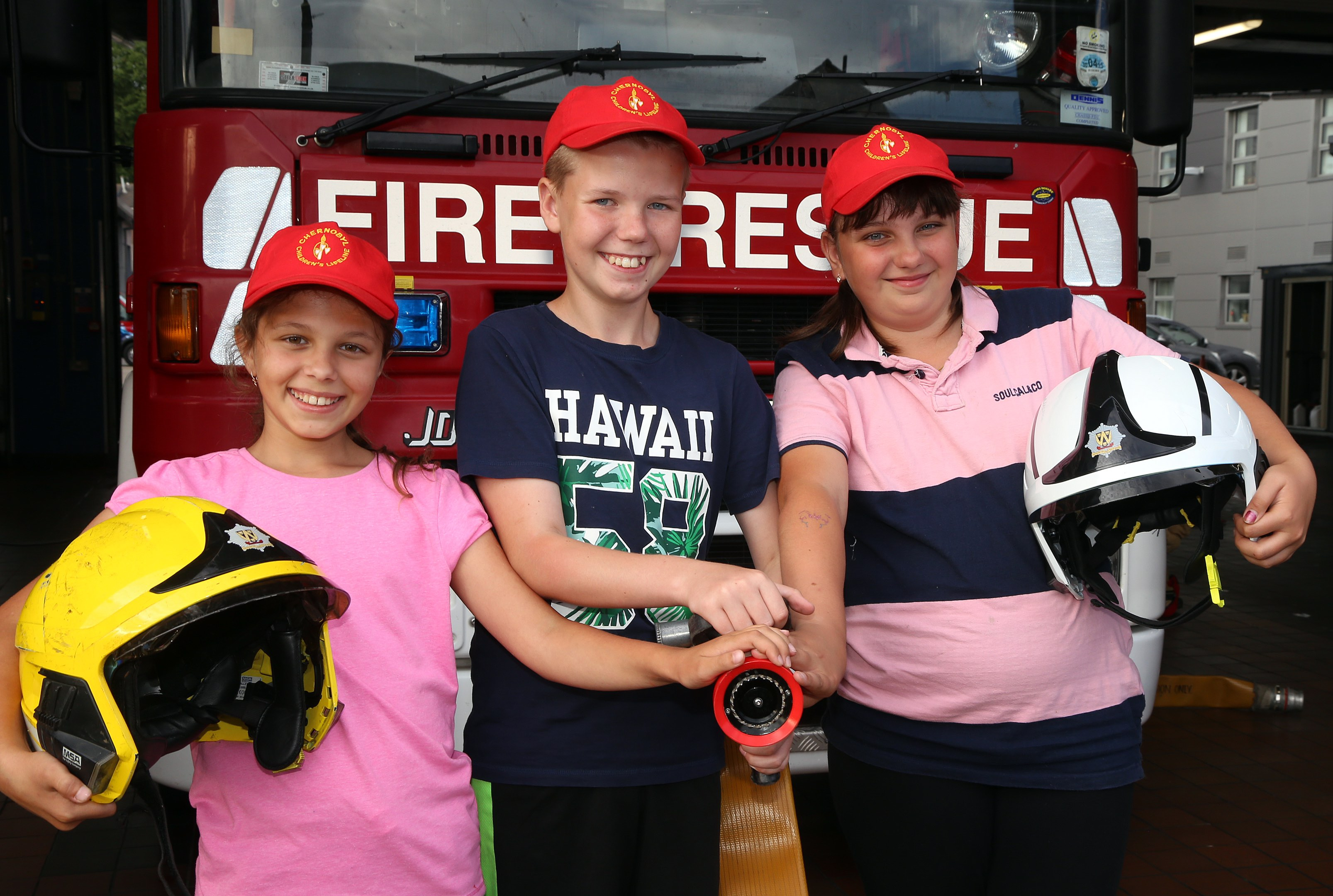 The children with the hose and helmets are L-R, Diana Kamesh (10), Andrey Demidenko (11) and Mariya Kuzmenko (12).