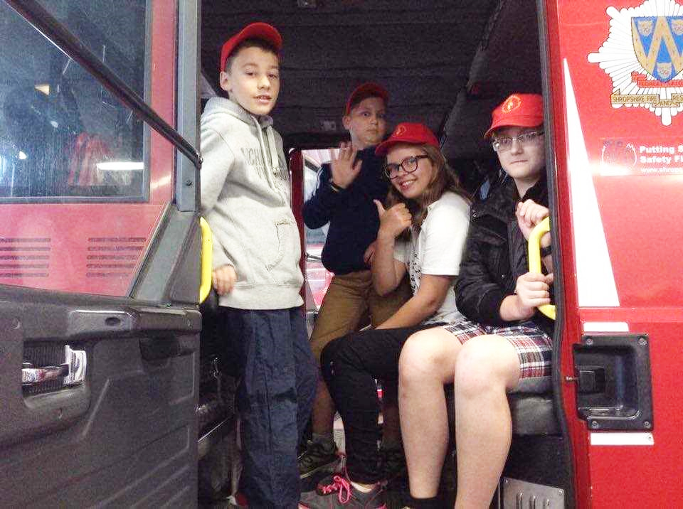 All aboard a fire engine at Shrewsbury Fire Station for the Belarus children.