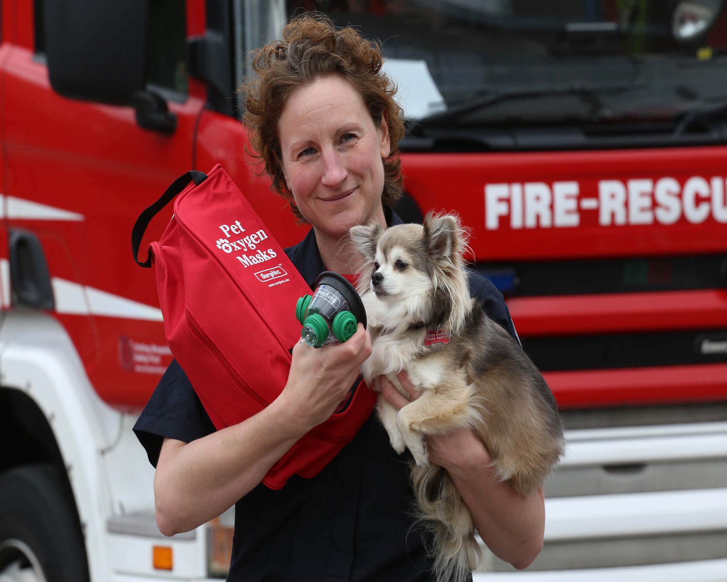Telford firefighter Louise Fletcher with her pet Chihuahua, Cloud, raised funds to buy five of the masks.