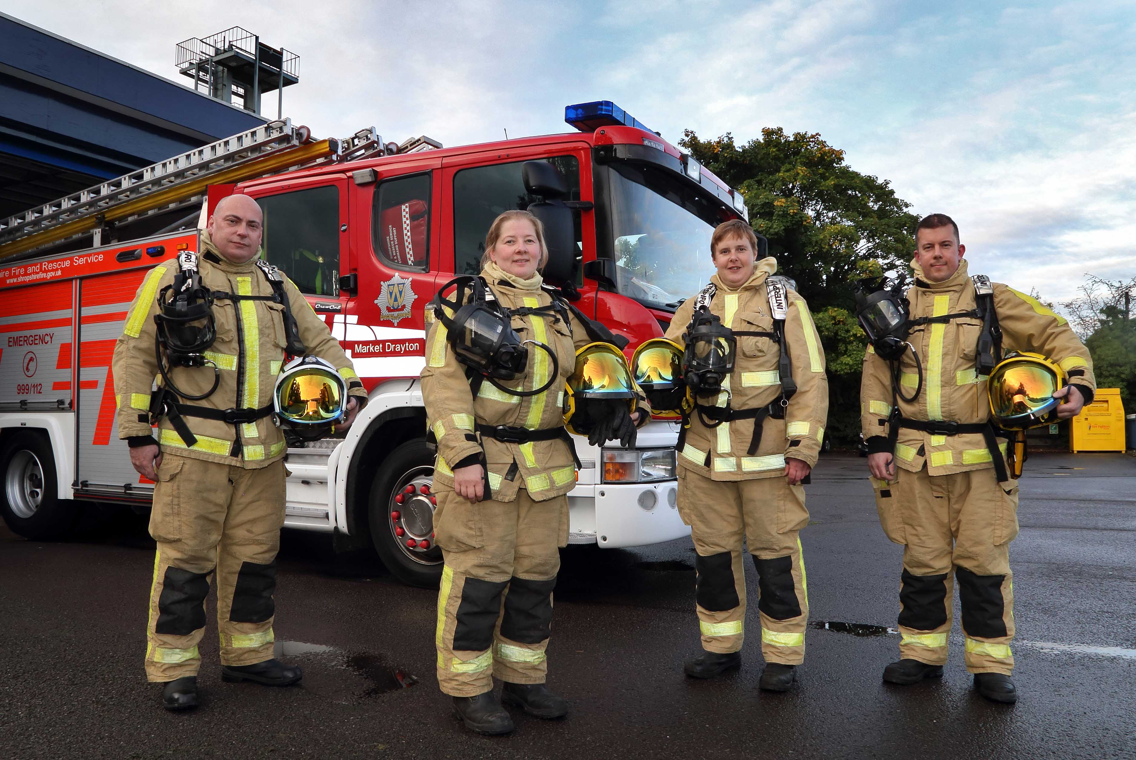The same line up but without breathing apparatus: Market Drayton Fire Station's Watch Manager Mark Smith with firefighters Sarah Cartwright, Sally Eynon, who is working towards becoming a crew manager, and firefighter Leon Turner.