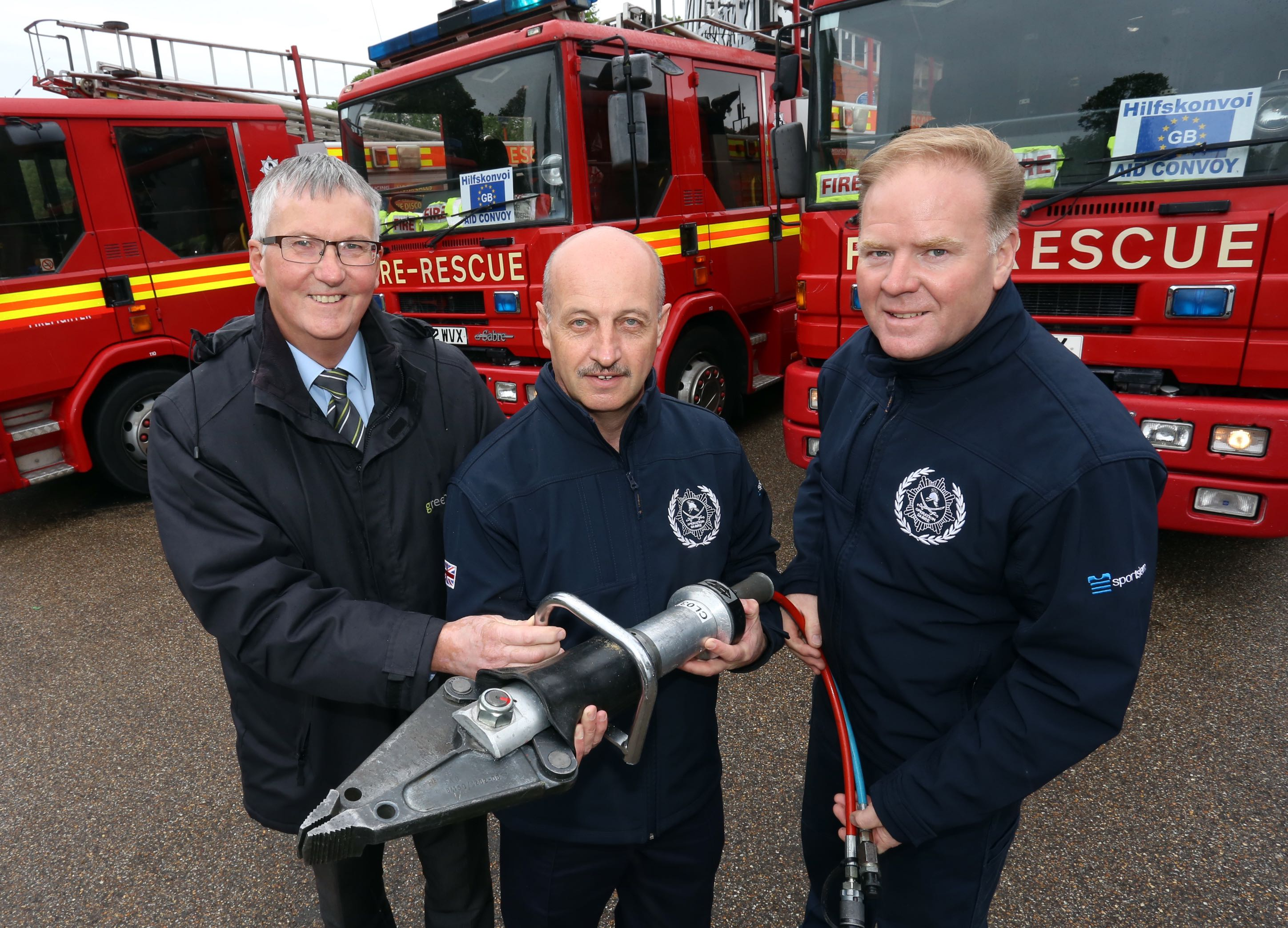 Martin James, (left) of Greenhous, Shrewsbury presents Steve Worrall, with the cutting equipment, pictured with Malcolm Price, a retired firefighter and former member of Shropshire and Wrekin Fire Authority.