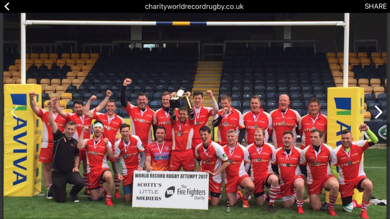 Bridgnorth firefighter Luke Veal (in green sleeves) at the end of the 30 hour world beating rugby challenge for charity