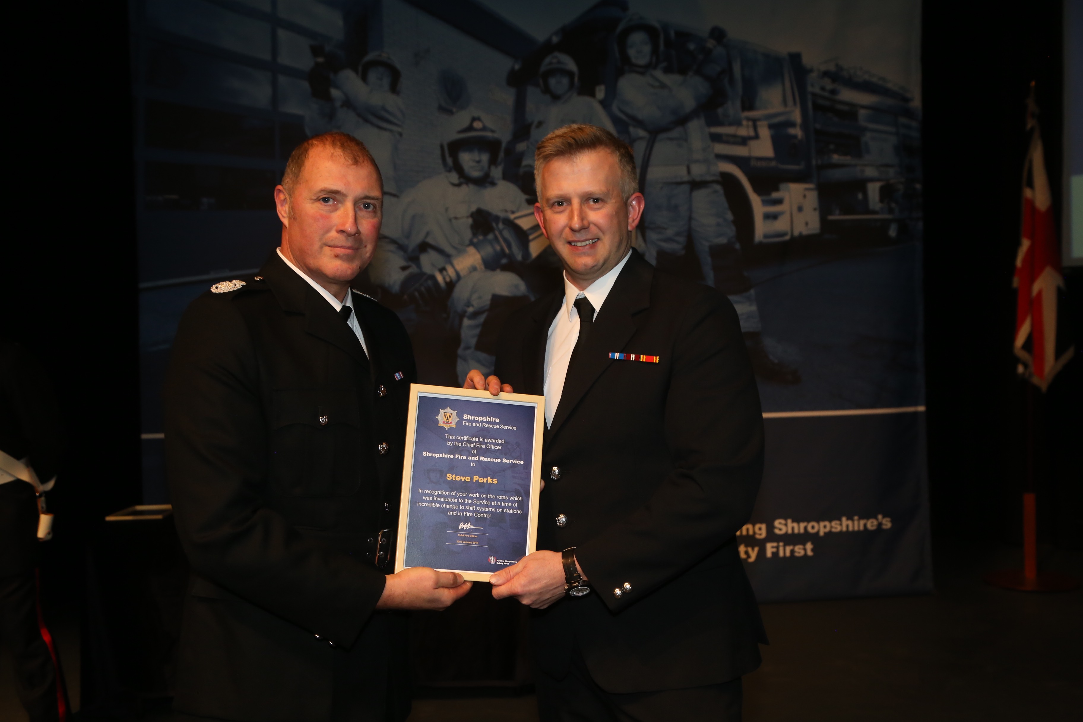 Steve Perks receives a certificate of recognition for exemplary service