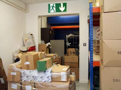 photo of a really cluttered corridor leading to a fire exit