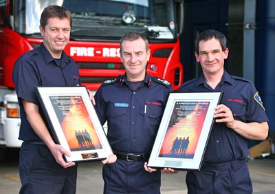 Chief Fire Officer Paul Raymond with firefighters John Bee and Richard Glazier and their awards