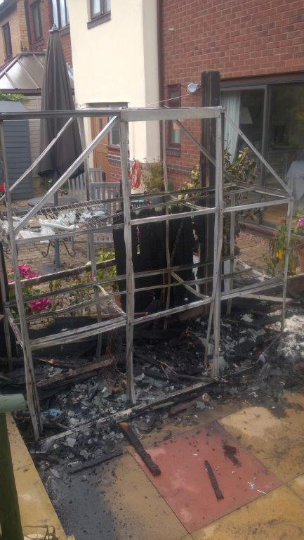 A greenhouse was destroyed in another fire caused by a gas burner as flames spread towards a Telford house.