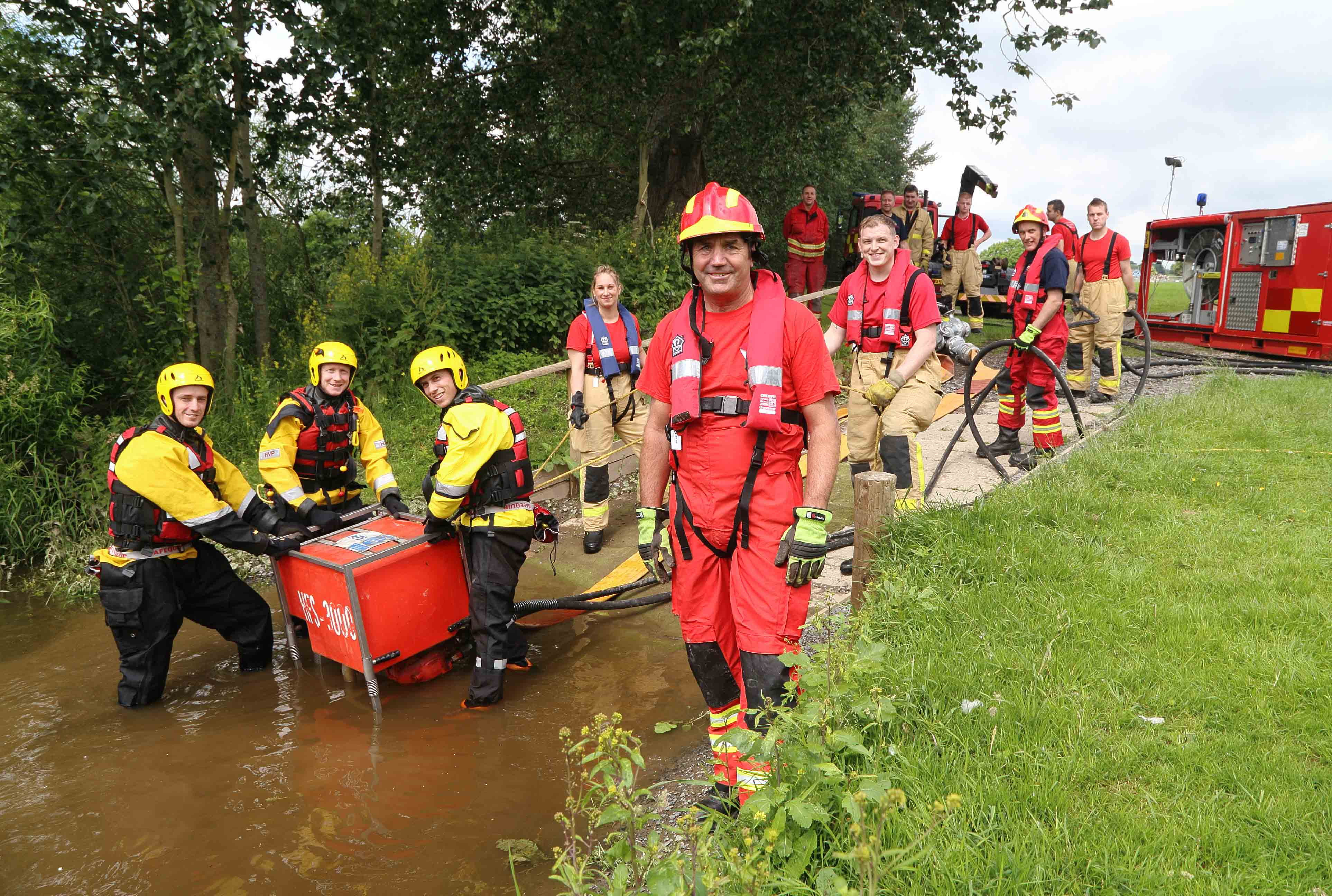 Tactical advisor Mac Harris with firefighters at the West Midlands showground by the River Severn in Shrewsbury, in training for the next floods disaster