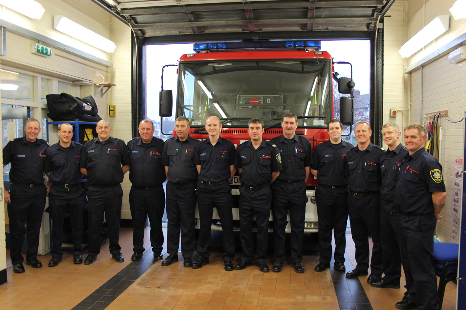 "Watch Manager Tony Peck (far left)is in charge of Prees Fire Station and has been an ""on call"" firefighter for nearly 32 years. He is pictured with his crew."