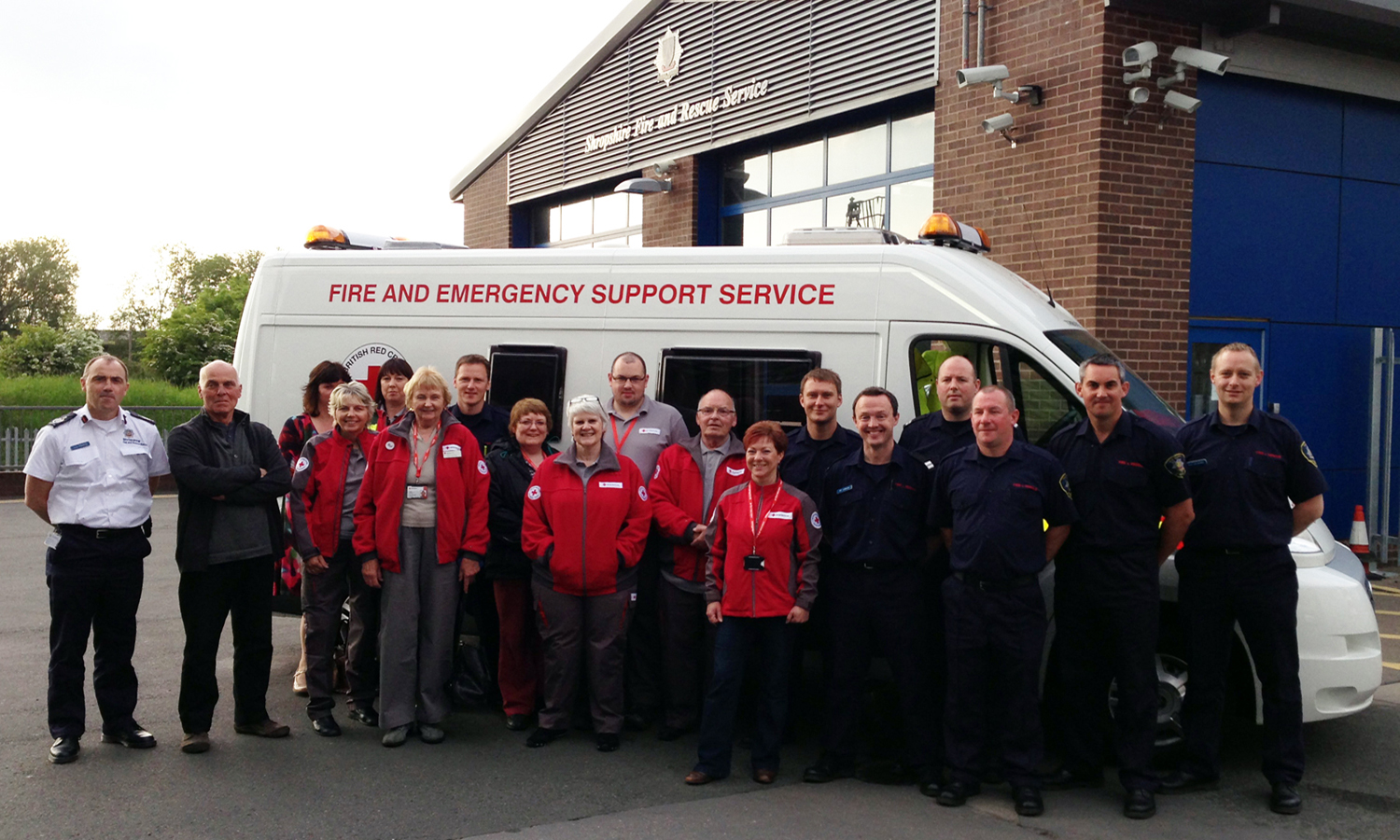 Volunteers with members of White Watch Shrewsbury and (far left) Chief Fire Officer John Redmond and Red Cross operations director Andrew Strong.