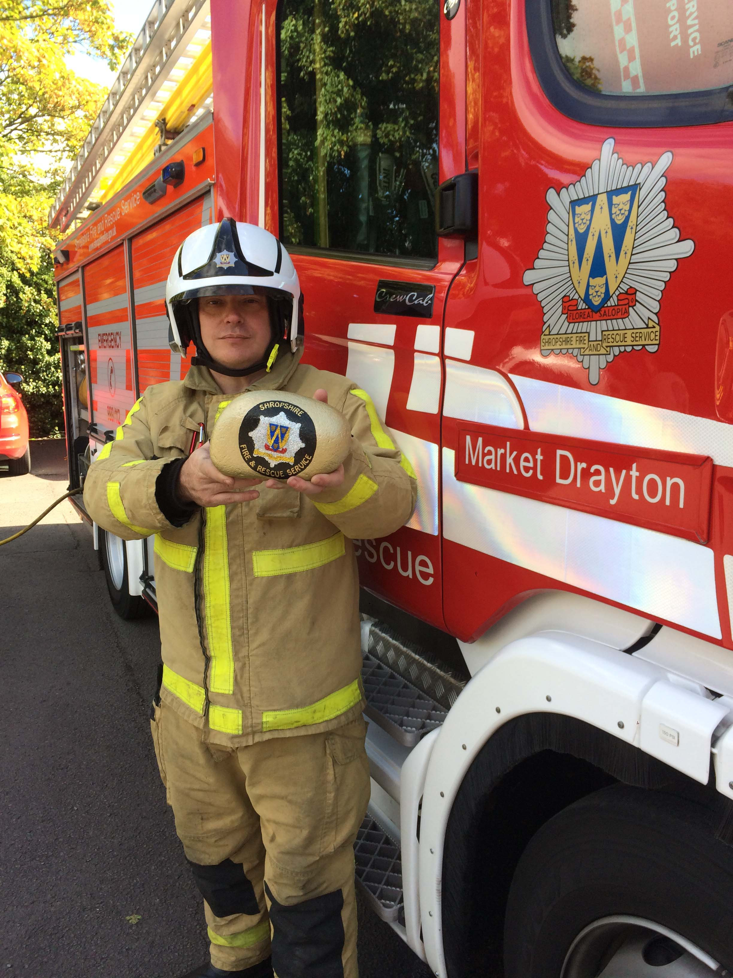 Firefighter Mark Smith with the golden rock