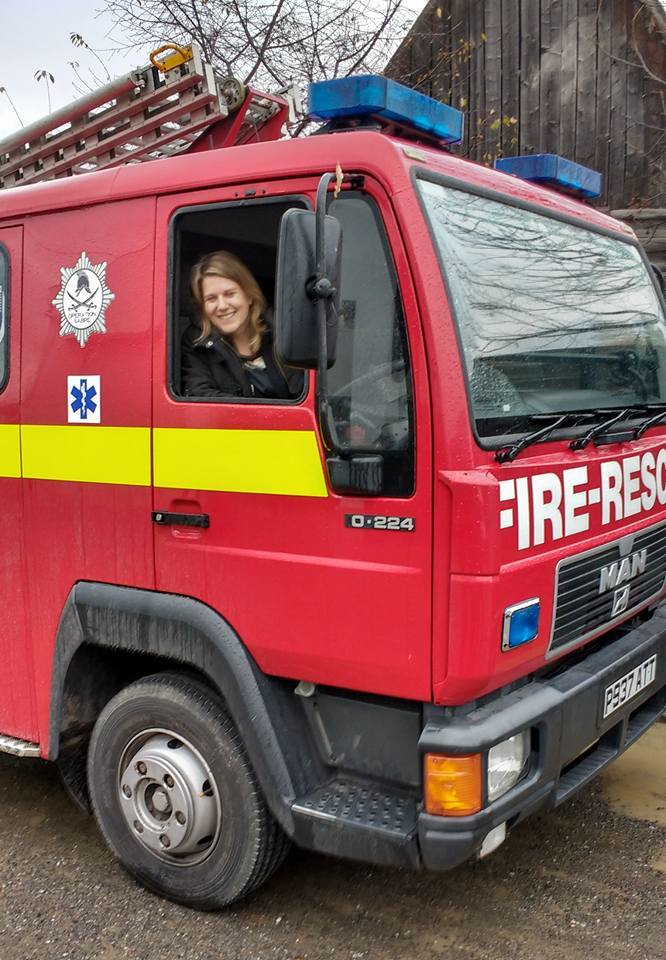 Alex Gregory, the British Embassy representative in Romania, aboard the UK replacement fire appliance