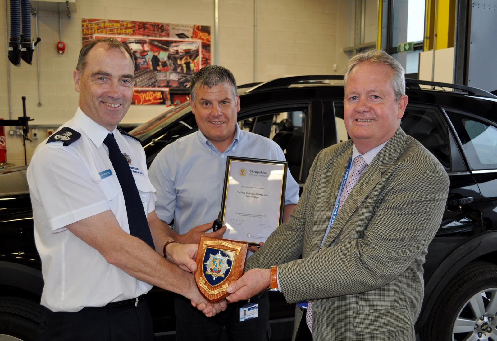 Chief Fire Officer John Redmond thanks TCATs John Hampson (centre) and Jim Hillman.