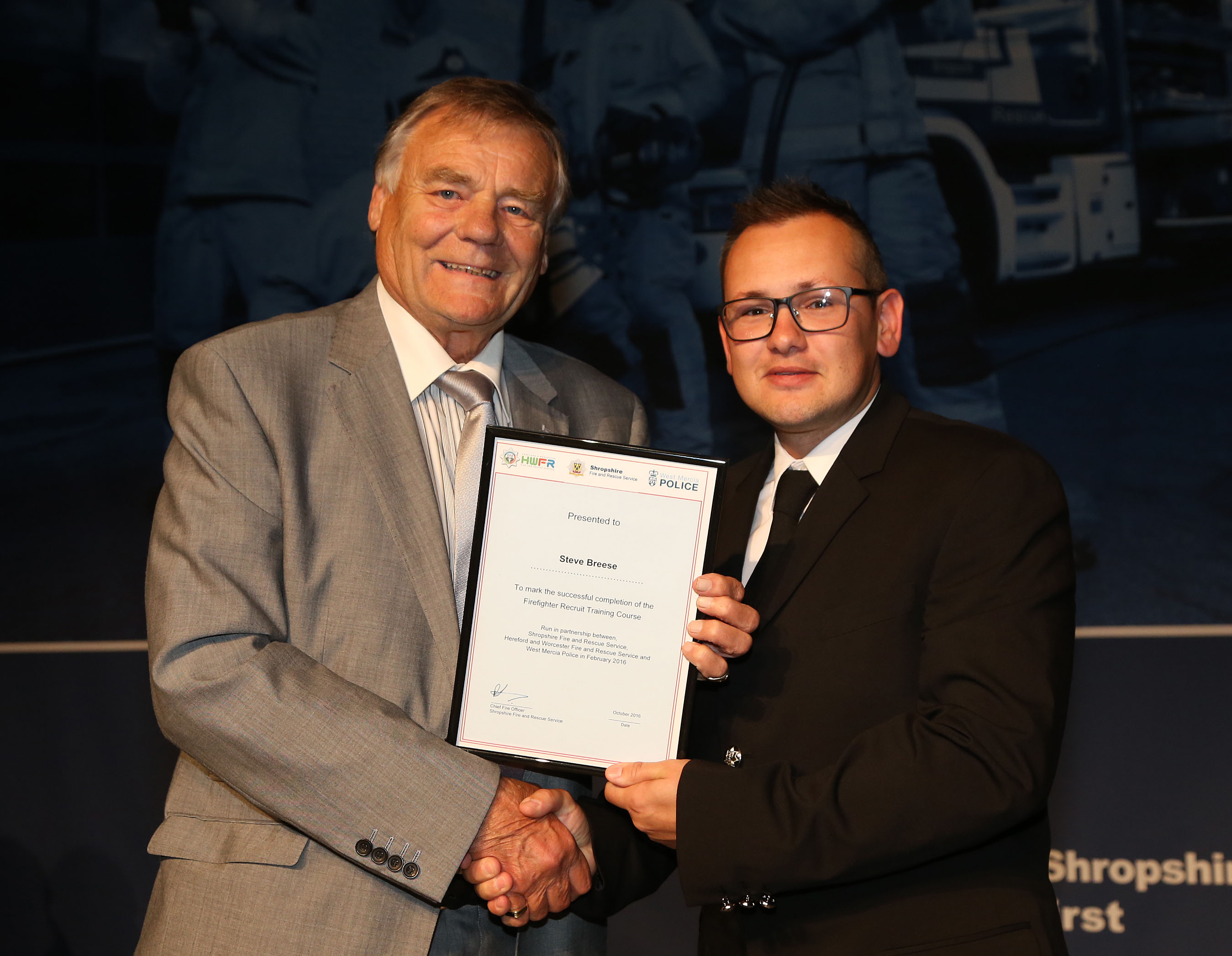 Albrighton PCSO Steve Breese won the top student award for his firefighter training course. He is pictured with Councillor Eric Carter.