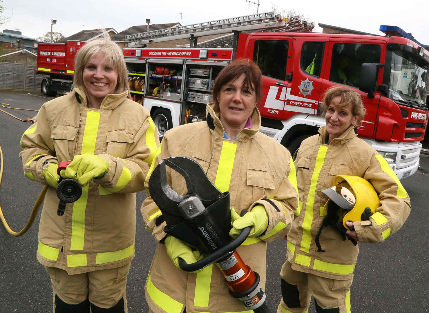 Sally Mawhinney (centre) holds cutting gear used to free people trapped in their vehicles with Tracey Keene (left) and Sylvie Harley (right)