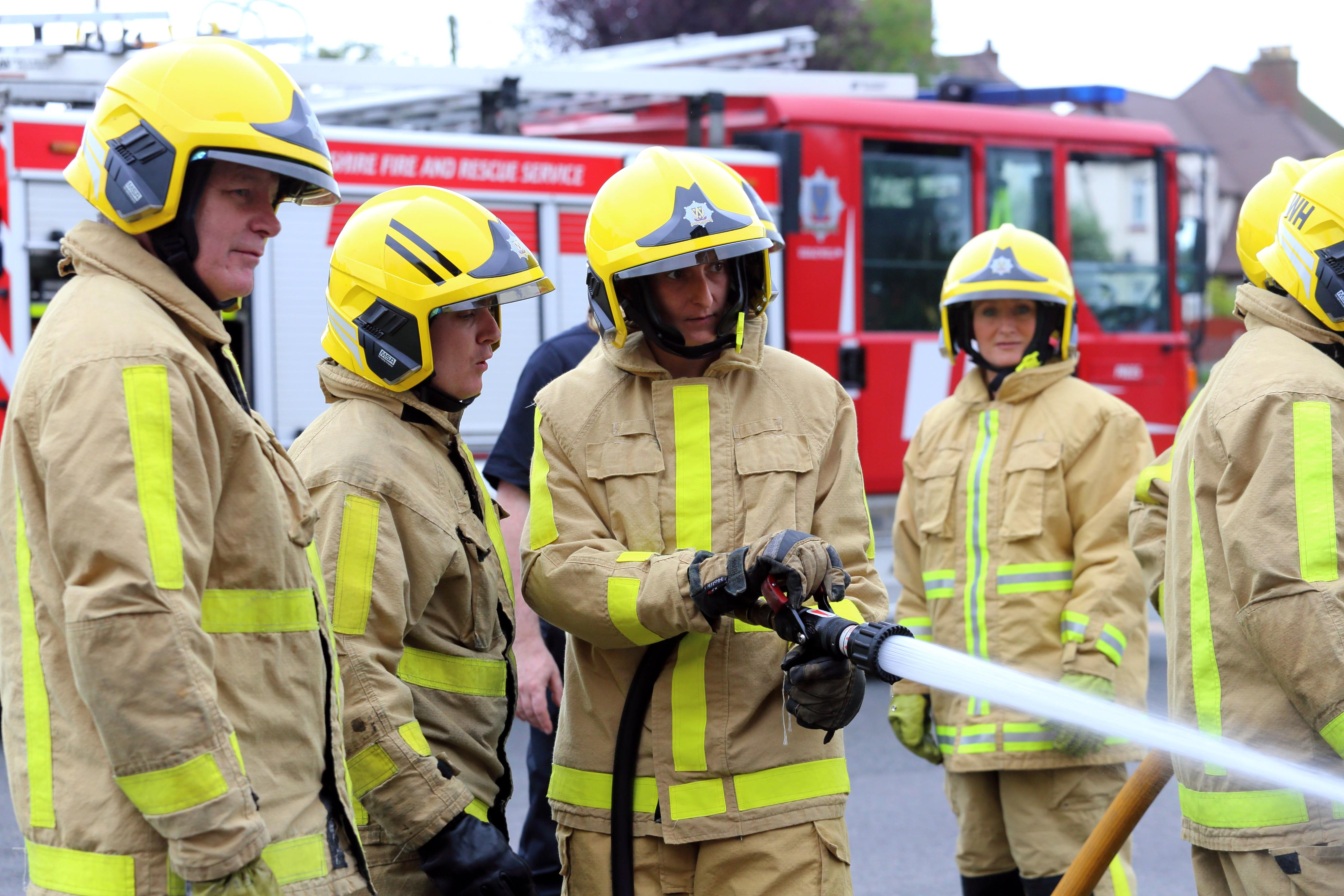 Julie Collins tries out the firefighter hose at the taster event.