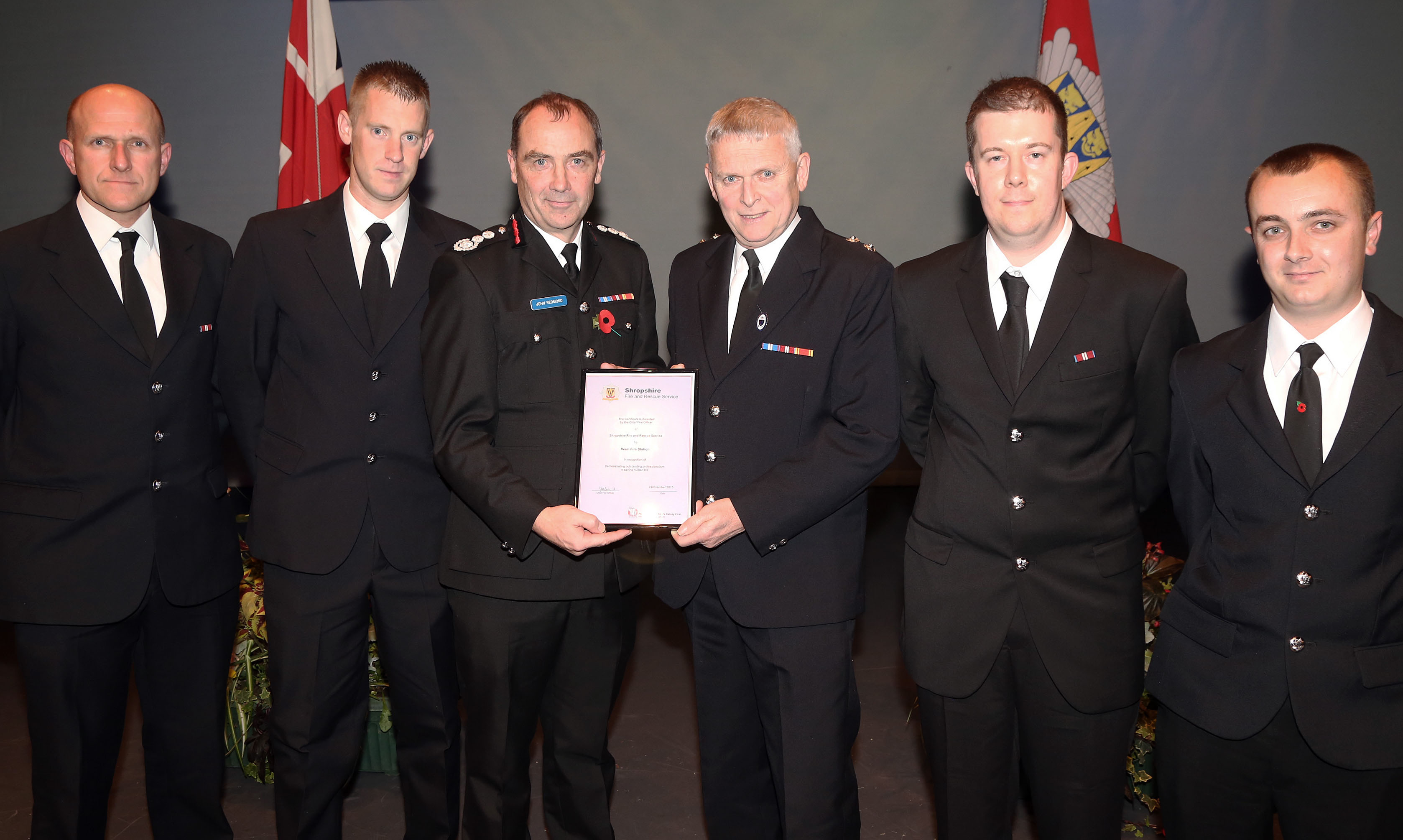 Watch Manager Phil Smith receives the award from Chief Fire Officer John Redmond on behalf of Wem's fire crew for saving a life. Left to right, John Green, Gary France, John Redmond, Phil Smith, Leon Turner and Darren Jones.  Vic Young (not pictured) was also involved in the rescue.