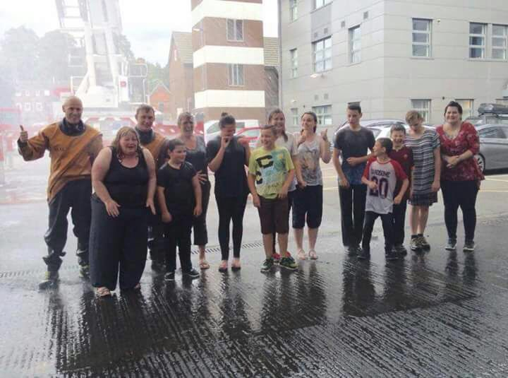 They got a bit wet at Shrewsbury fire station but they had fun. Pictured with firefighters Andrew Sullivan and Andy Davies.