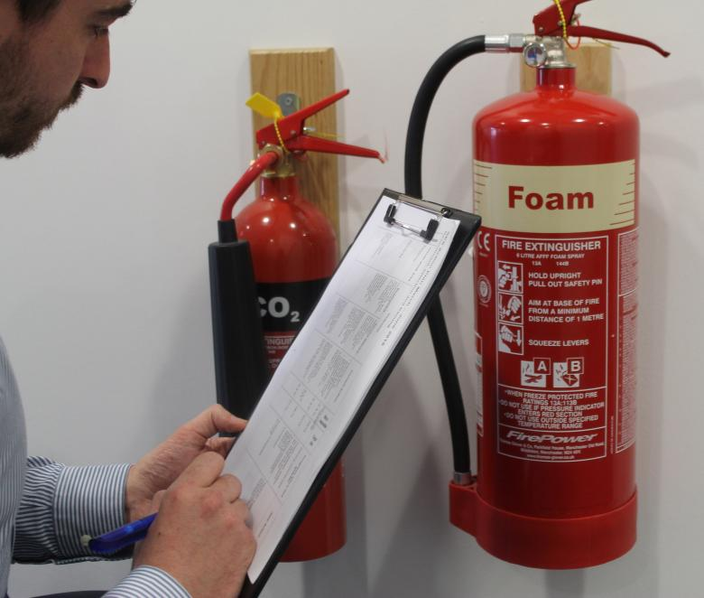 Fire Risk Assessor inspects fire extinguishers