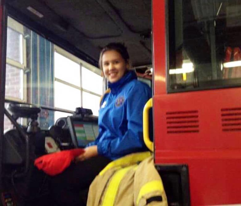 Angelina (16) sits happily aboard a Shropshire fire truck just days before she found out she is in remission from cancer caused by the nuclear fallout in Chernobyl more than 30 years ago.