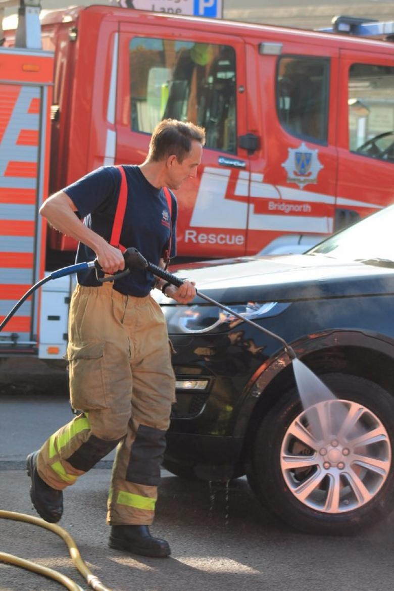 Bridgnorth firefighter John Allen in action during the charity car wash
