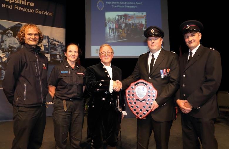 Blue Watch, Shrewsbury, were one of many award winners at last night's ceremony. Here they receive the Good Citizens' Award from High Sheriff Charles Lillis for giving fun and laughter to children from Chernobyl who they have hosted in Shrewsbury every summer for more than 20 years. Left to right, firefighters John Robinson, Annie Nicholas, Richard Meadows and Paul Gray with Eric Carter (centre) vice chair of Shropshire and Wrekin Fire Authority.