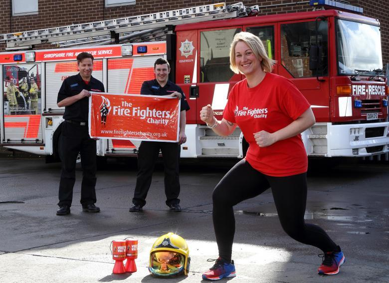 Clun firefighter Kat Frost gets ready for the London Marathon in aid of the Fire Fighters Charity pictured at Shrewsbury Fire Station with Shrewsbury firefighters Kris Mullins and Stuart Hughes