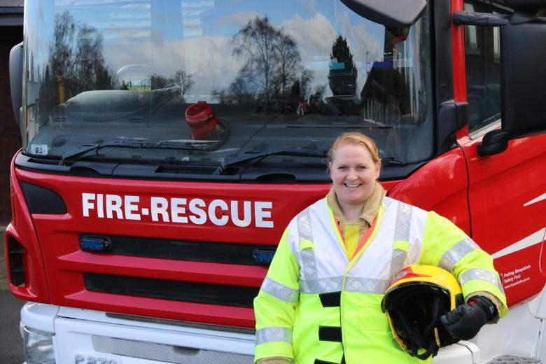 Baschurch firefighter Elaine poses in front of a fire engine