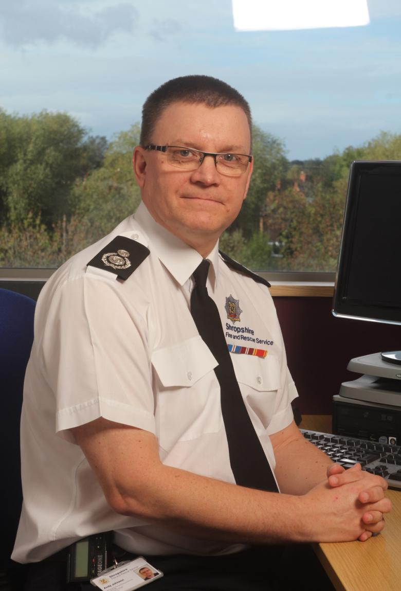 picture of assistant chief fire officer Andy Johnson at his desk