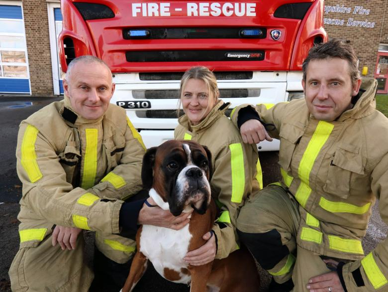 Ralph the Boxer dog with White Watch at Wellington Fire Station. Pictured with firefighters Stuart Page, Jenni Cranage and Tim Whitehouse.