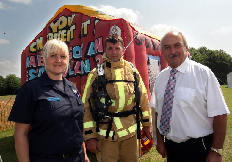 2 firefighters with Fire Authority member at Crucial Crew in Shropshire