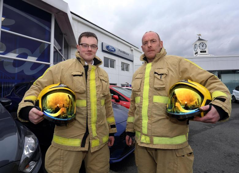 Furrows employees Chris Smith and Glen Wheatley are first to the fire station to answer a 999 call.