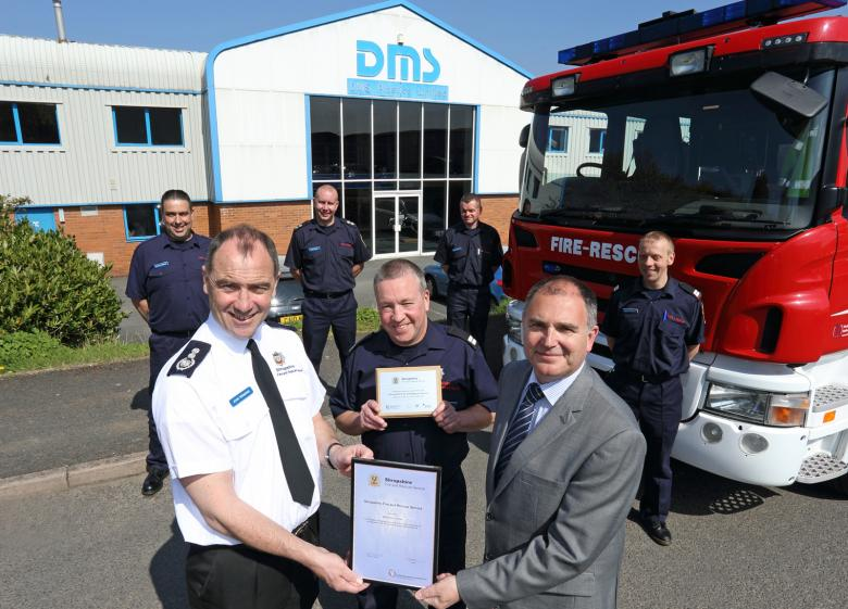 Chief Fire Officer John Redmond presents a certificate and plaque to Ludlow mayor Paul Draper, General Manager at DMS Plastics, for the company's 25 year support for on call firefighters. He is pictured with firefighter James Bond and colleagues, l to r, Shaun Harrison, Watch Manager Dale Pound, Jason Norgrove and Mark Nicholas.